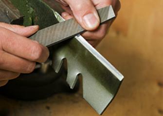 sharpening lawn mower blades